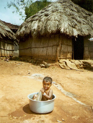 Katkari child waiting for a bathc
