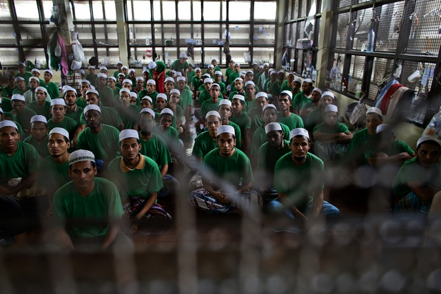 Undocumented Rohingya Muslim immigrants gather at the Immigration Detention Center during the Muslim holy fasting month of Ramadan in Kanchanaburi province, Thailand on July 10, 2013. © 2013 Reuters