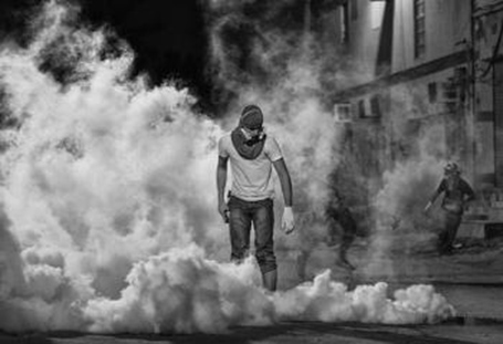 The winning photo chosen by Freedom House showing a Bahraini protestor standing in a cloud of teargas after suppressing a peaceful gathering he had participated in,