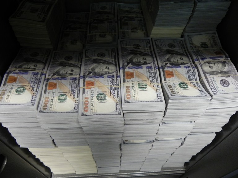 At one location during Wednesday's takedown in Los Angeles, FBI agents seized nearly $3 million in cash.