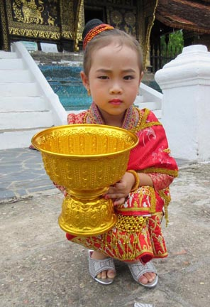 Little girl at Wat Xieng Thong Temple. Photograph © Mark Ulyseas