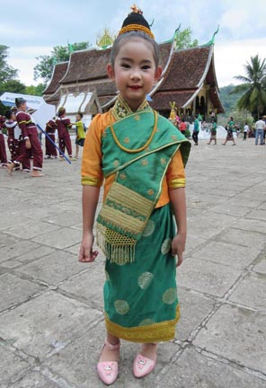 Young girl at Wat Xieng Thong. Photograph © Mark Ulyseas