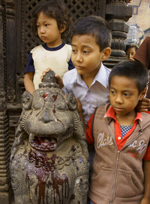 03. Children watching the beheading of a buffalo. © Joo Peter