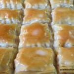 Pour in the luke warm milky syrup over cooled cooked filo pastry and let the pastry to soak the milky syrup for 35- 40 minutes. Pic © Ozlem Warren