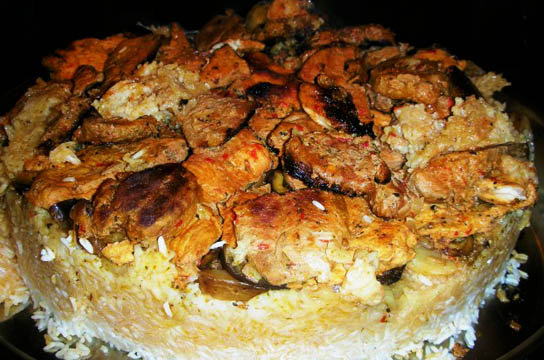Mevlubi - upside down rice with layers of sauteed eggplant, potatoes and meat. Pic © Ozlem Warren