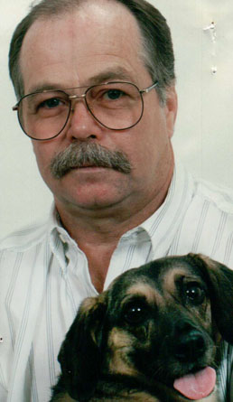Dad and his dog Munchkin. She was the inspiration for me and my Dad to start the non-profit therapy animal group we founded together, K-9's for Compassion.
