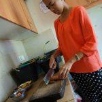 Volunteer preparing food