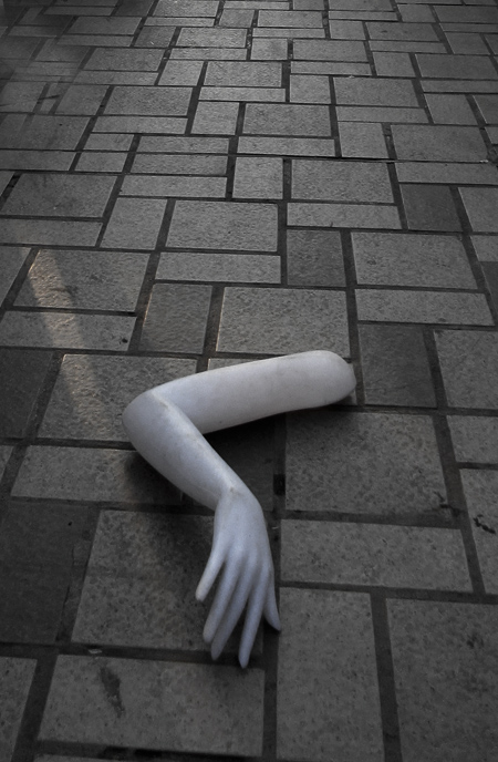 Severed hand of a mannequin discarded on the sidewalk. Photograph by Mark Ulyseas