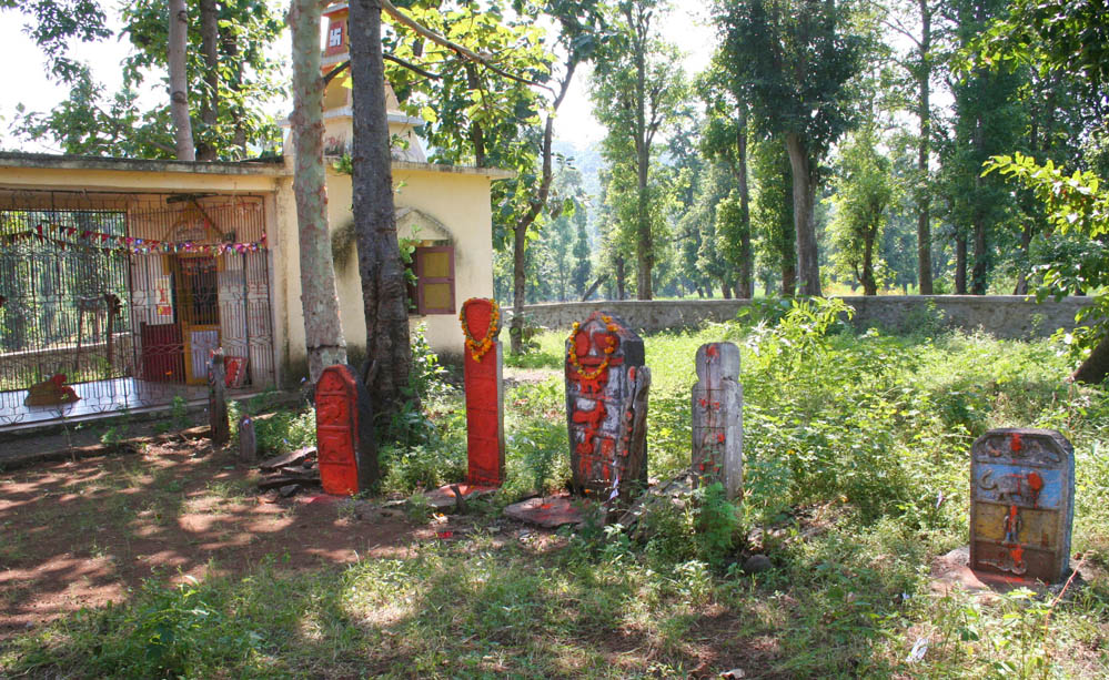 The refurbished sacred abode. In the foreground stand vaghdev plaques of earlier times.