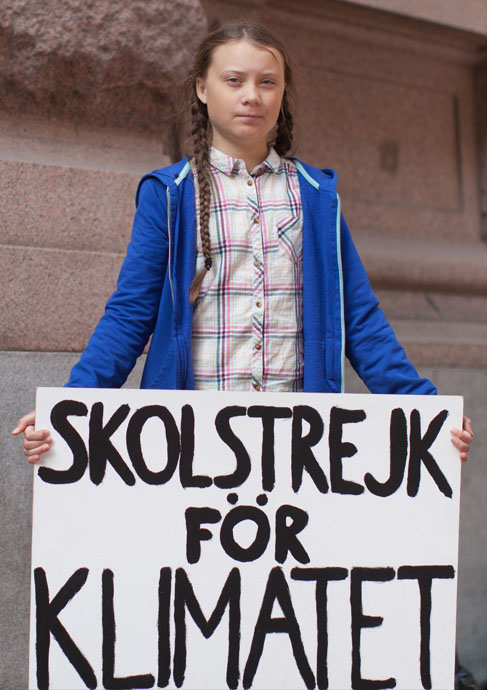 In August 2018, outside the Swedish parliament building, Greta Thunberg started a school strike for the climate. Photograph by Anders Hellberg. https://commons.wikimedia.org/wiki/File:Greta_Thunberg_4.jpg