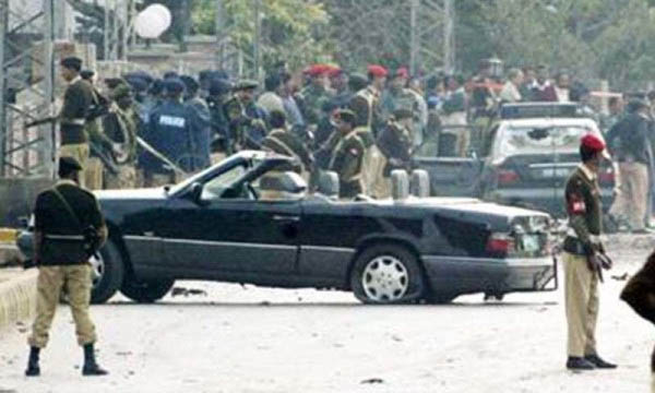 Pakistani soldiers stand guard near the damaged cars of Gen. Pevez Musharraf's motorcade in Rawalpindi in December 2003, Photo Courtesy: The Dawn