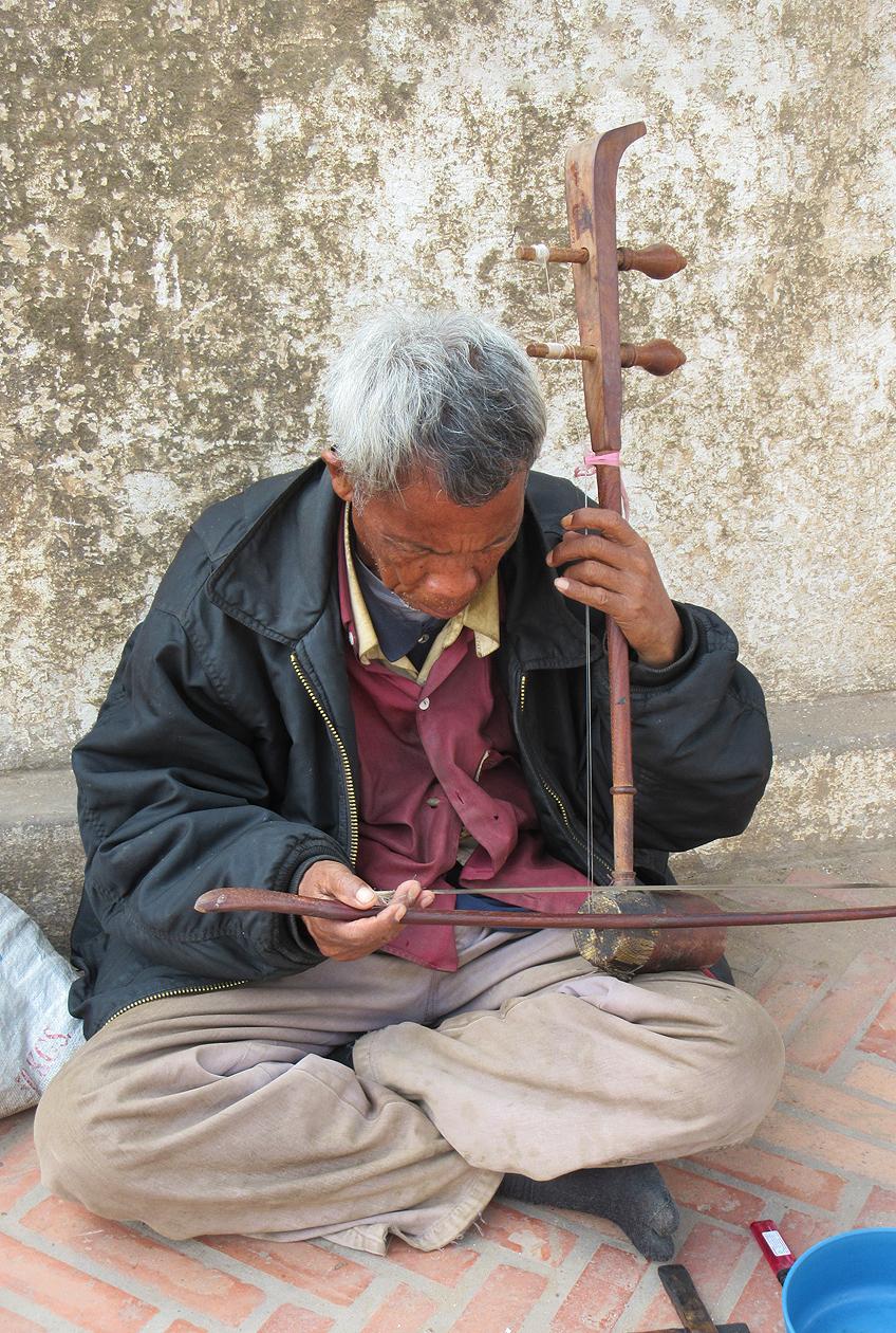 Street Musician, photograph by Mark Ulyseas