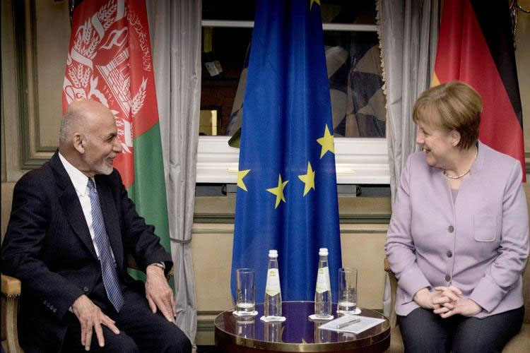 Afghan President Ashraf Ghani in dialogue with German Chancellor Angela Merkel.