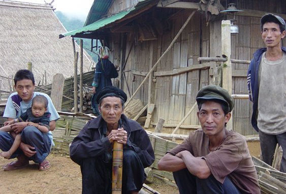 Village elders sharing a smoke. Photograph by Percy Aaron